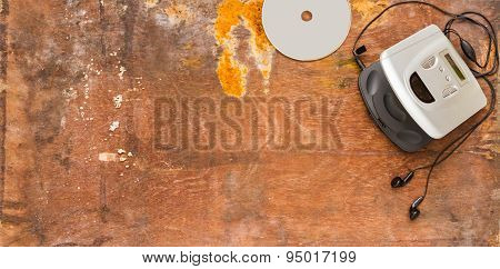 Cd Player On Brown Wood Background For Listen.