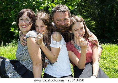 Summer Scene Of Happy Family At The Park