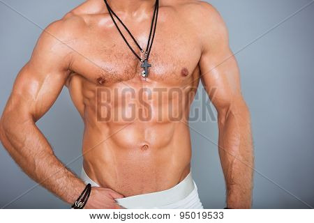 Muscular and sexy torso of young sport man. Bodybuilder body with perfect abs, chest, bicep, triceps