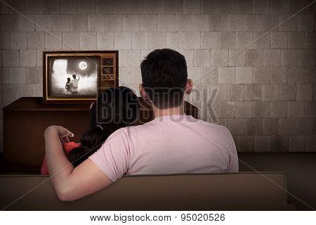 Young Asian Couple Watching Retro Tv