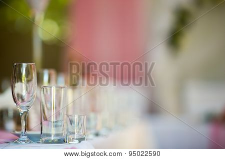 Three empty glasses on banquet table in restaurant