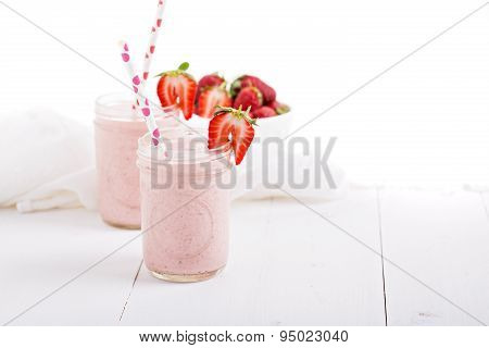 Strawberry milkshake in mason jars