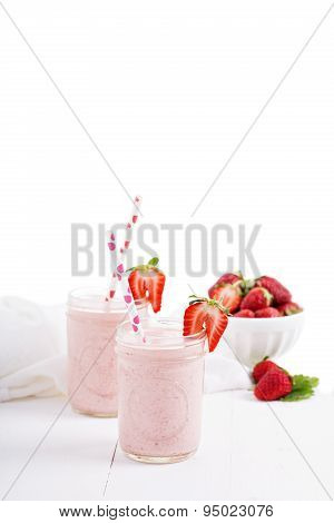 Strawberry milkshake in mason jars