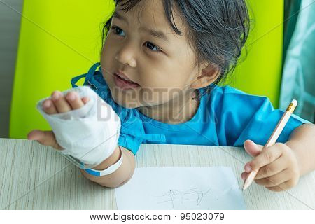 Illness Asian Kids Writing Paper On Desk In Hospital, Saline Intravenous (iv) On Hand