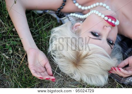 Portrait Of Woman On Grass