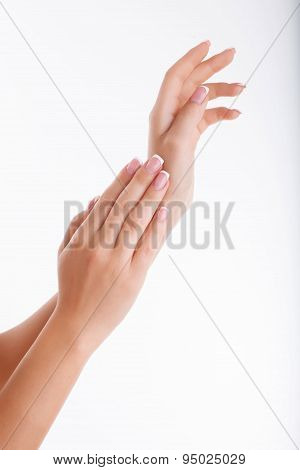 Beautiful human hands with cared manicured nails