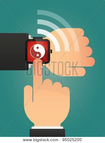 Hand Pointing A Smart Watch With A Ying Yang