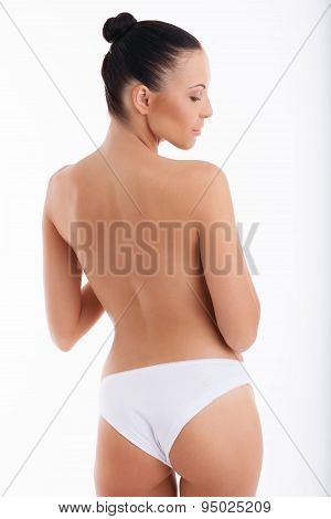 Beautiful young woman is presenting her body