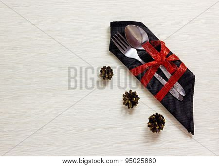Silverware With Fir Cones On White Wooden Background.christmas Table