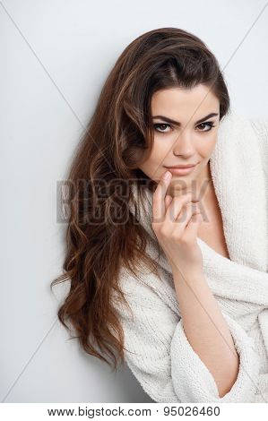 Beautiful young woman is in white bathrobe