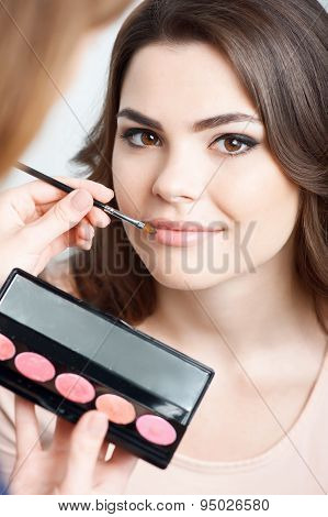 Pretty young woman is preparing for meeting