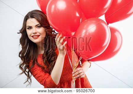 Pretty young woman in red dress is celebrating
