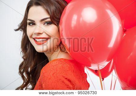 Beautiful young girl in red dress is making fun