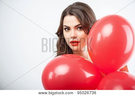 Pretty young woman is celebrating and doing fun
