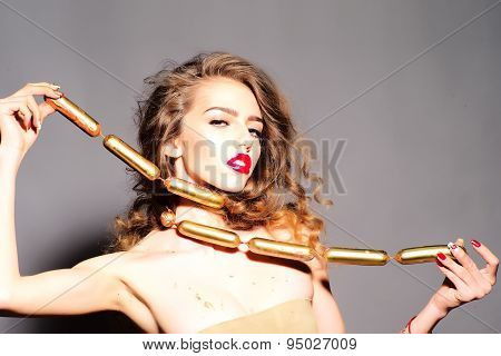 Beauteous Young Girl With Gold Sausages