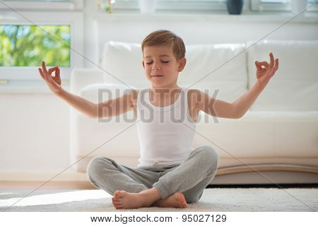 Happy Little  Boy Exercising At Home