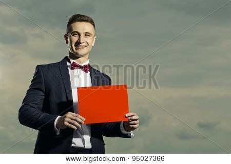 Smiling Man In Suit With Sheet Of Paper