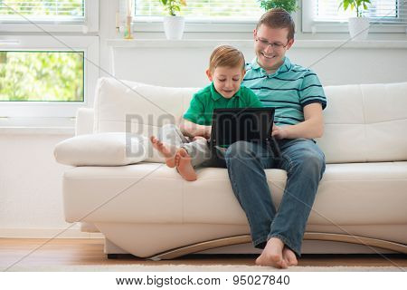 Happy Father And Child Playing At Home