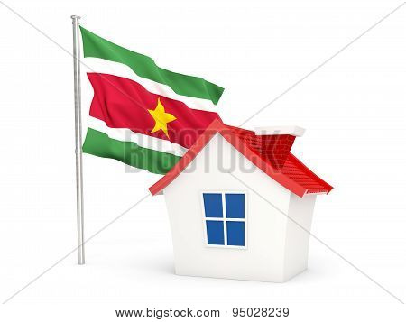 House With Flag Of Suriname