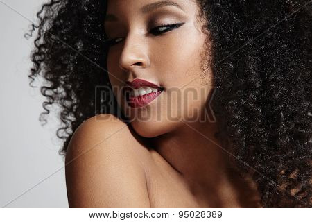 Prettu Latin Woman Smiling And Looking Aside