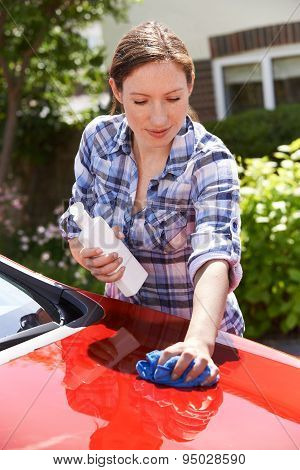 Woman Waxing Car Outside House