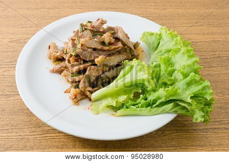 Spicy Grilled Beef Salad On A Wooden Table