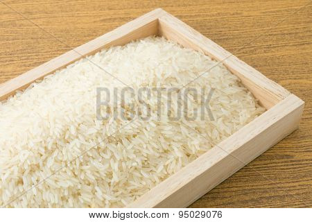 Thai Jasmine Rice In A Brown Wooden Tray
