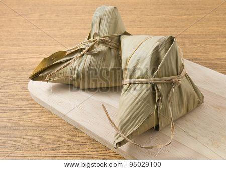 Zongzi Or Sticky Rice Dumpling On Wooden Board