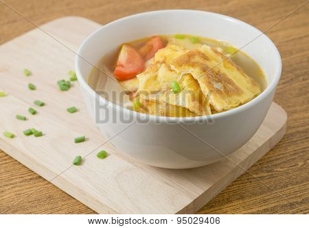 Thai Omelet Soup With Tomatoes And Chopped Scallion