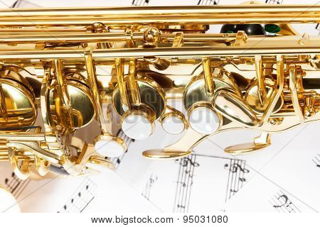 Shiny golden alto saxophone keys close-up view