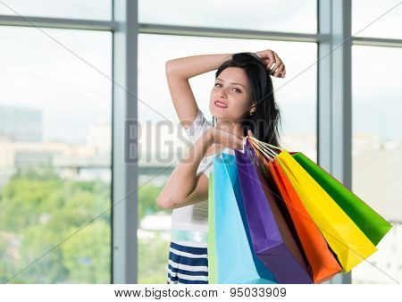Beautiful Smiling Brunette Woman With The Colourful Shopping Bags From The Fancy Shops. Panoramic Vi