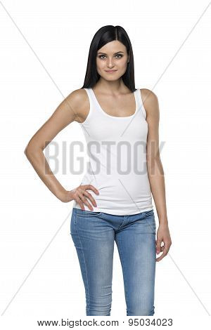 Close Up Of A Brunette Lady In A Tank Top And Denims. Isolated.