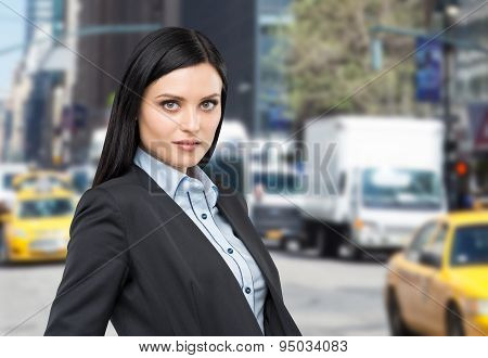 Portrait Of A Beautiful Brunette Lady In A Formal Suit. New York Street Background.