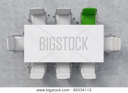 Top View Of A Conference Room. A White Rectangular Table And Eight Chairs Around, One Of Them Is Gre