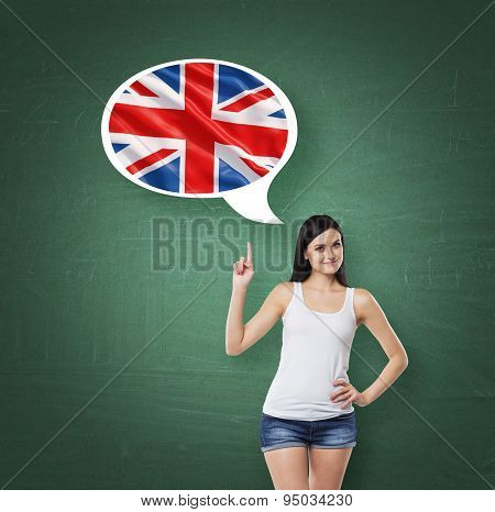 Beautiful Woman Is Pointing Out The Thought Bubble With Great Britain Flag. Green Chalk Board Backgr