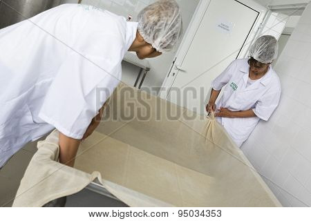 Women Wotking In A Creamery