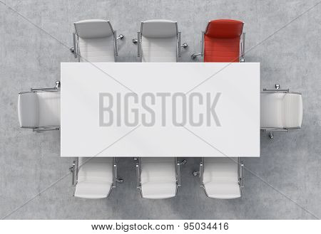Top View Of A Conference Room. A White Rectangular Table And Eight Chairs Around, One Of Them Is Red