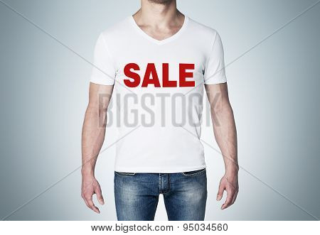 Close Up Of The Body View Of The Man In A White T-shirt With The Red Word ' Sale ' On The Chest. Blu