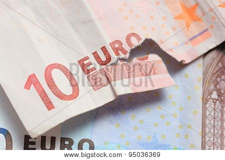 Torn Euro Note And Vintage Greek Coin