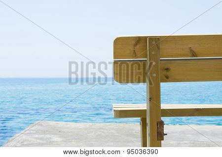 Wooden Bench With The  Look At Blue Sea