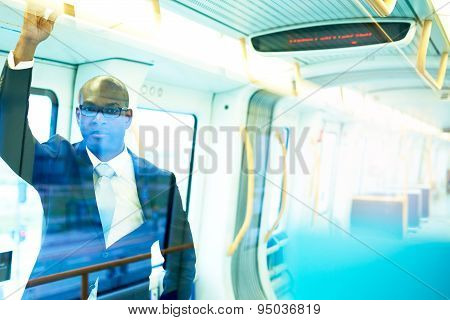 Businessman In A Train With Light Reflections