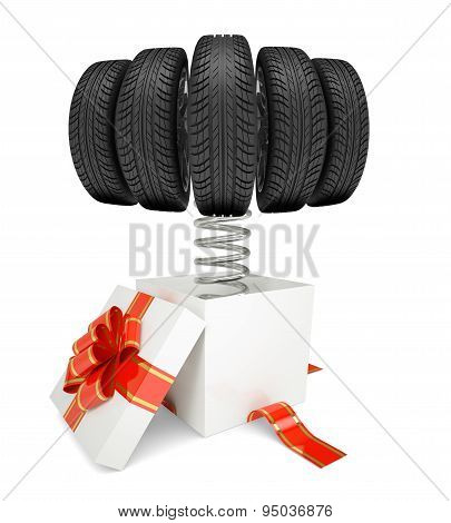 Gift box with red band and car tires