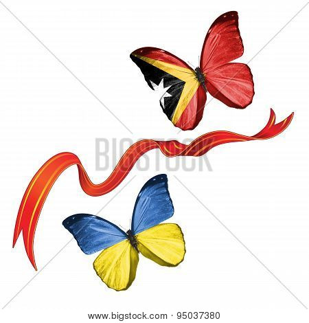 Two butterflies with symbols of Ukraine and East Timor