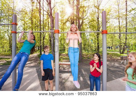 Happy children are chinning up on the playground