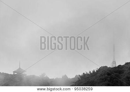 Japanese Pagoda And Radio Tower On Foggy Mountain