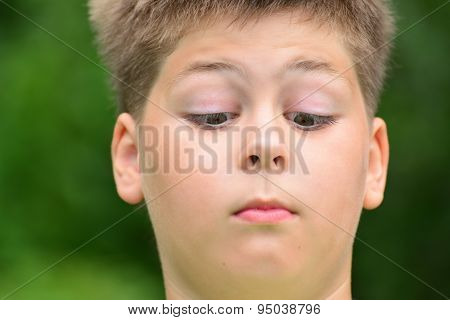 Teen Boy Squinted Down To His Nose