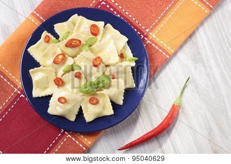 Portion Of Ravioli With Red Pepper
