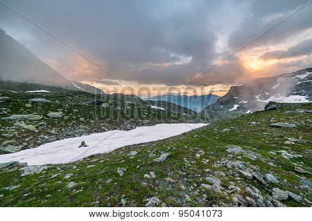 High Altitude Alpine Landscape And Cloudscape At Sunset