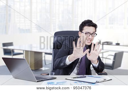 Businessman With Scared Expression In The Office