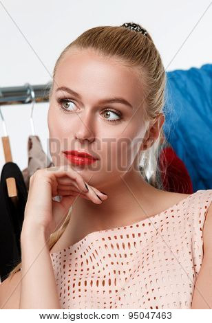 Beautiful Blonde Woman Suffering Near Wardrobe Rack